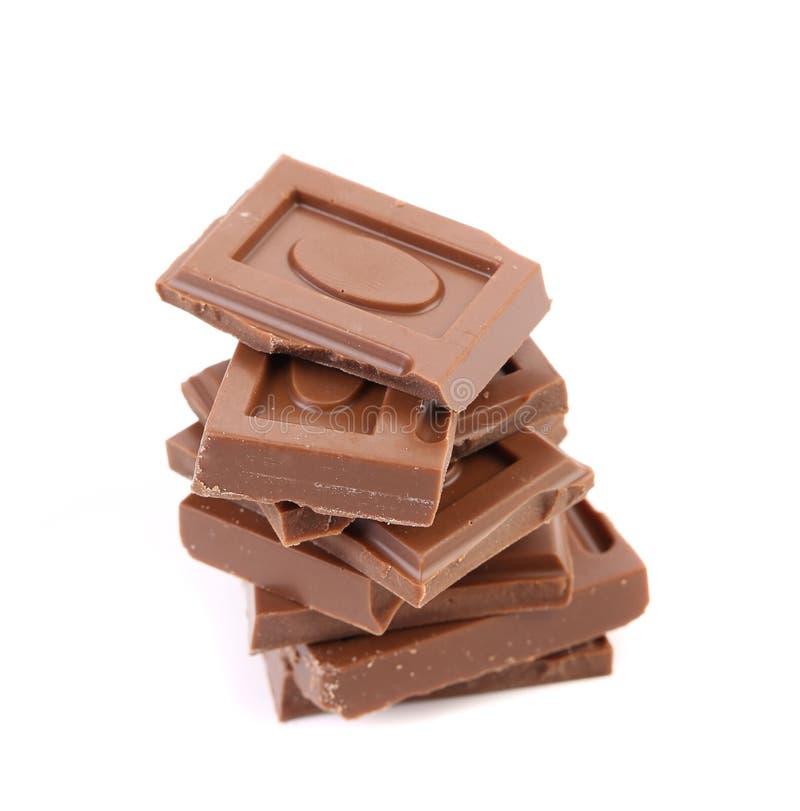 Pezzetto saporito di cioccolato al latte. immagini stock libere da diritti