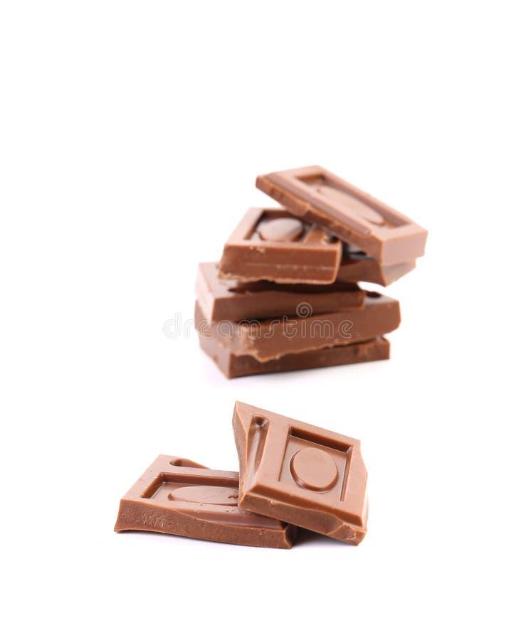 Pezzetto saporito di cioccolato al latte. fotografie stock