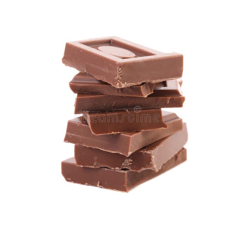 Pezzetto saporito di cioccolato al latte. immagine stock libera da diritti