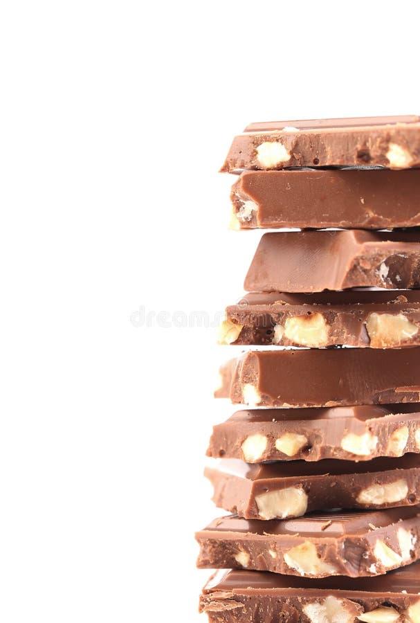 Pezzetto saporito di cioccolato al latte con i dadi. immagine stock