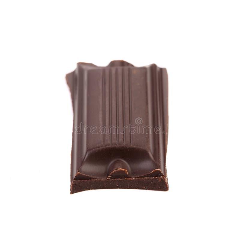 Pezzetto saporito di cioccolato fondente. immagine stock