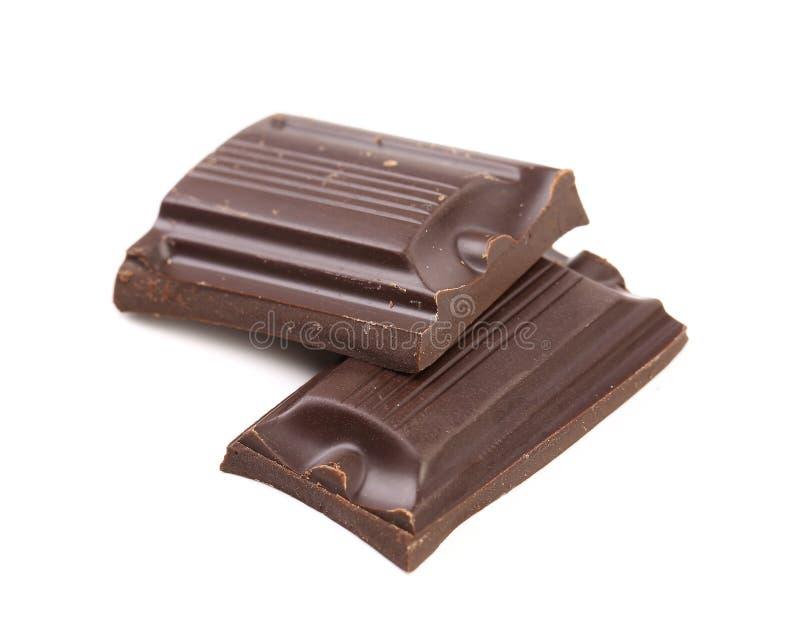 Pezzetto saporito di cioccolato fondente. fotografie stock