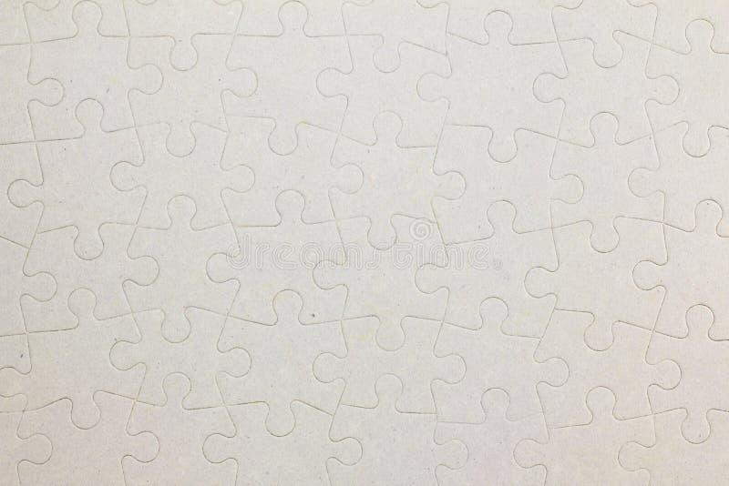 Pezzi in bianco collegati del puzzle come fondo fotografia stock libera da diritti