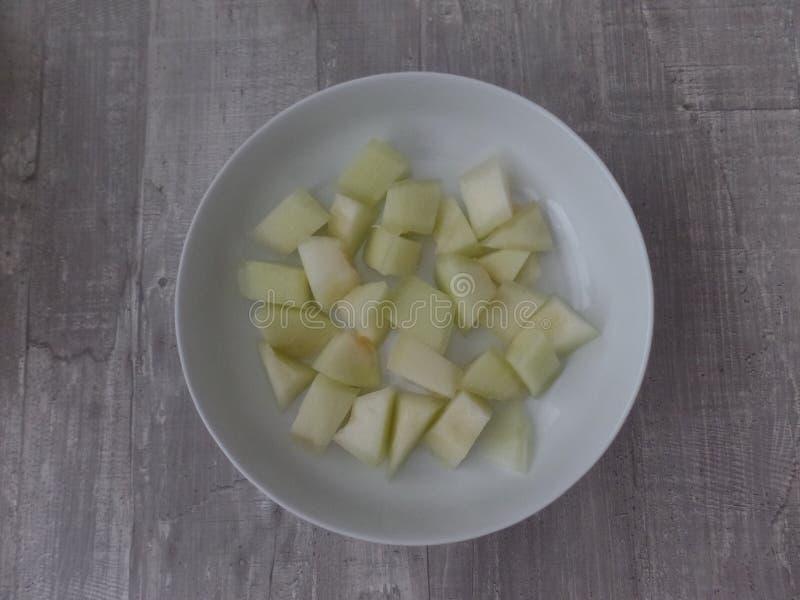 Pezzi di melone dolce della rugiada del miele fotografia stock