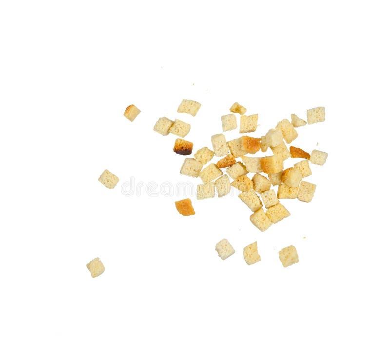Pezzi di pane integrale secco isolato su bianco immagine stock libera da diritti