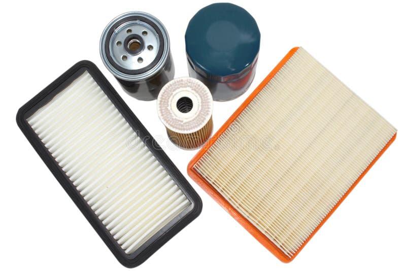 Pezzi di ricambio per l'automobile Filtri l'olio, il combustibile, aria isolata su fondo bianco immagine stock