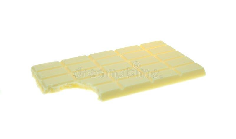 Pezzi e barra del cioccolato fotografia stock