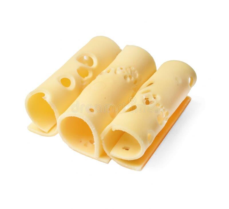 Pezzi rotolati del formaggio Fondo isolato bianco Vista laterale da sopra immagine stock libera da diritti