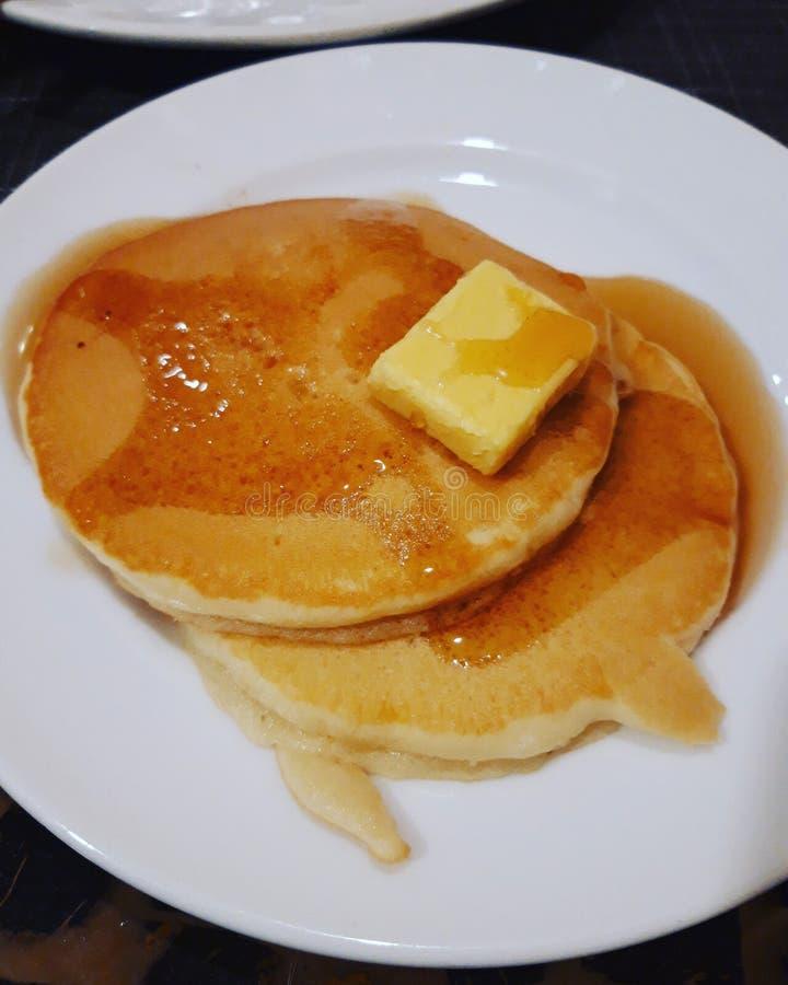 Pfannkuchen mit Butter lizenzfreie stockfotos