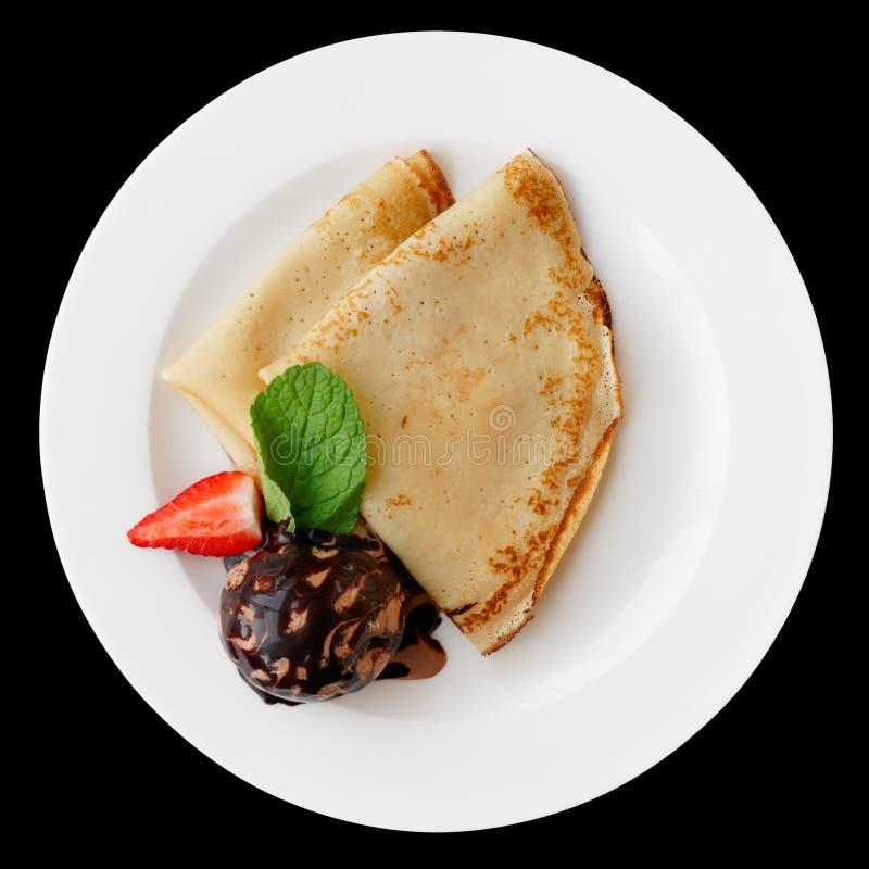 Pfannkuchen mit der SchokoladenEiscreme lokalisiert auf Schwarzem lizenzfreies stockfoto