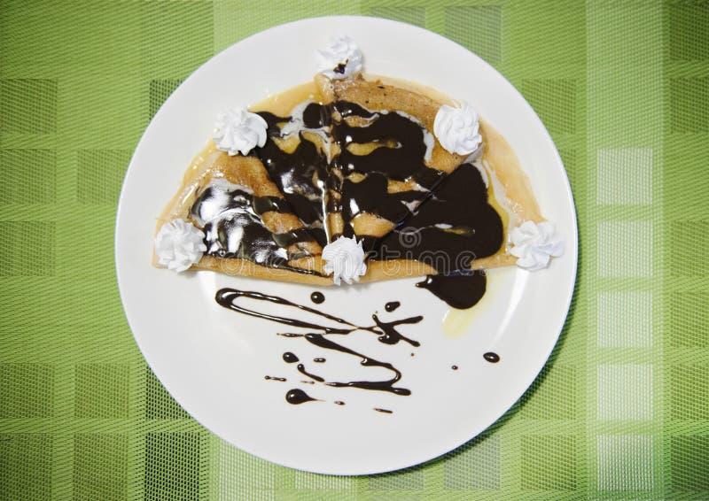 Pfannkuchen mit Schokolade stockbilder