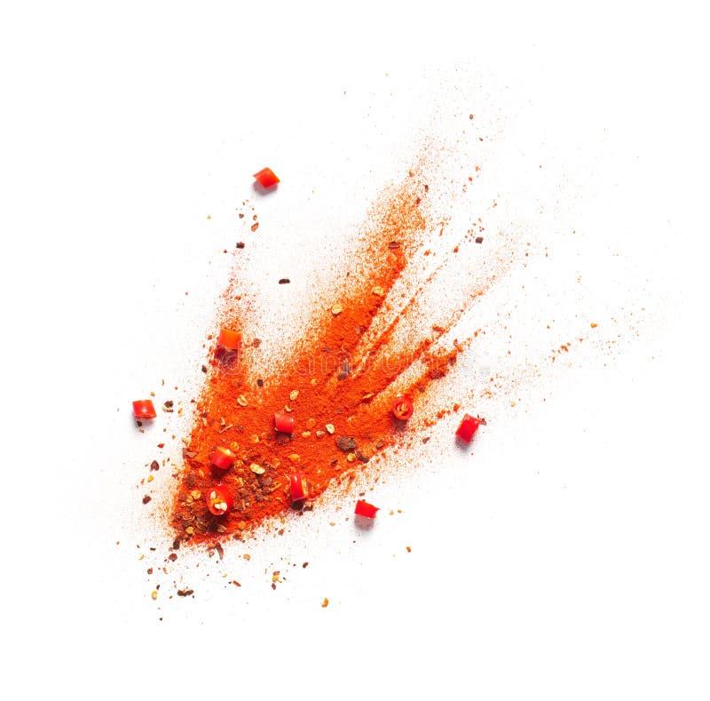 Pfeffer des roten Paprikas, Pulver und Flockenexplosion lizenzfreie stockfotos