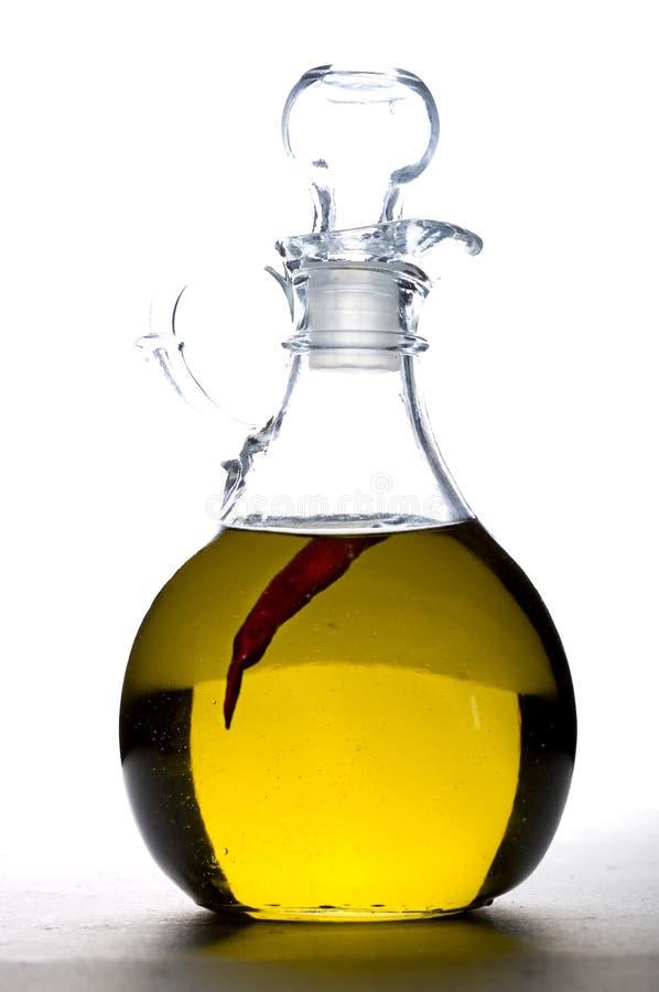 Pfeffer im Cruet Olivenöl. stockfotos