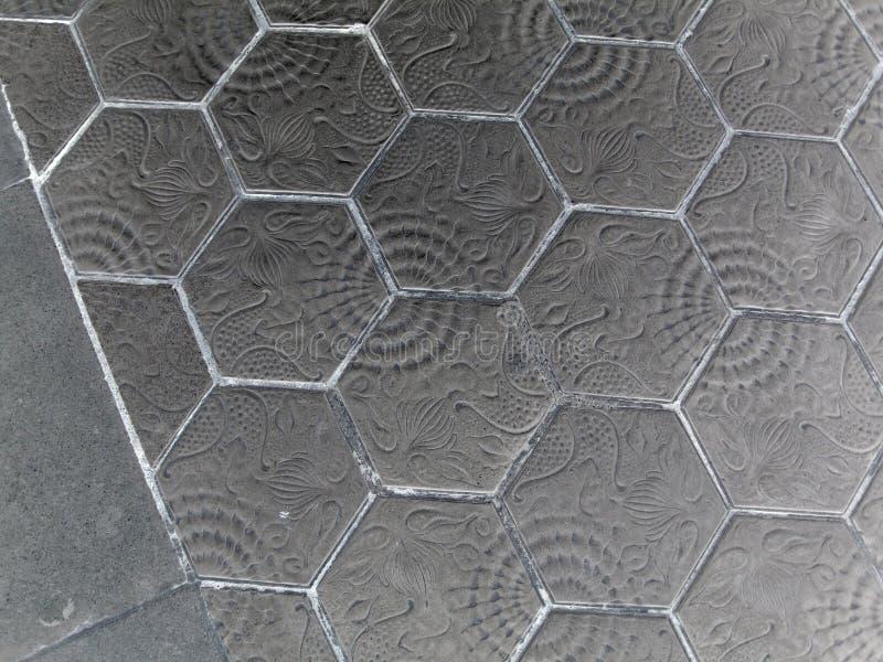 Pflasterung des Hexagonziegelsteingehwegs Das Muster der Steinblockpflasterung lizenzfreie stockbilder