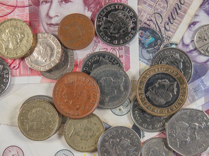 Pfundbanknoten und -münzen stockfoto