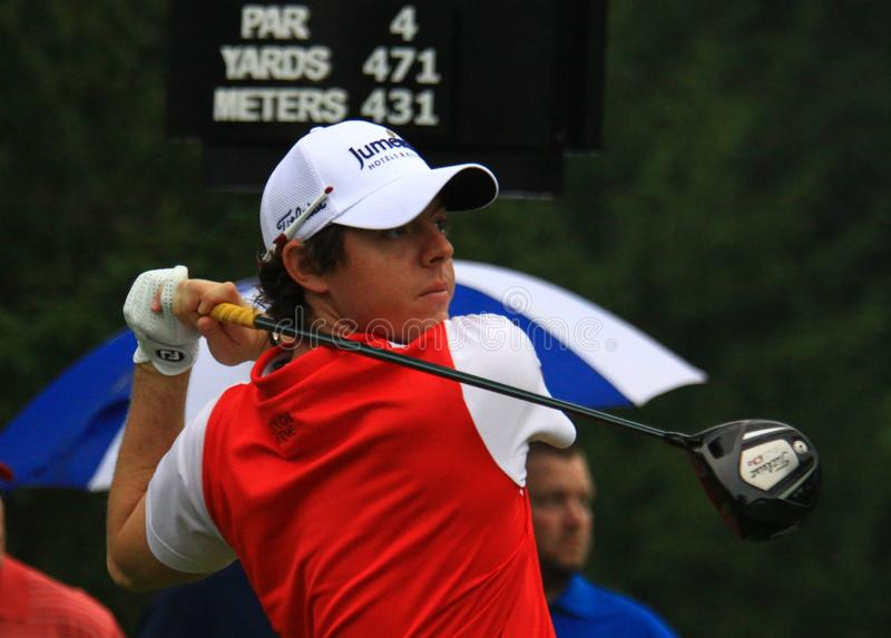 PGA golfer Rory McIlroy. Pro golfer Rory McIlroy prepares to hit the ball at the country clubs PGA golf event stock images