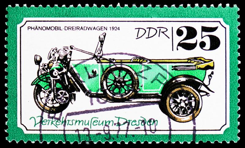Phänomobil three-Wheeler in 1924, Traffic Museum Of Dresden serie, circa 1977. MOSCOW, RUSSIA - FEBRUARY 20, 2019: A stamp printed in Germany, Democratic royalty free stock photo