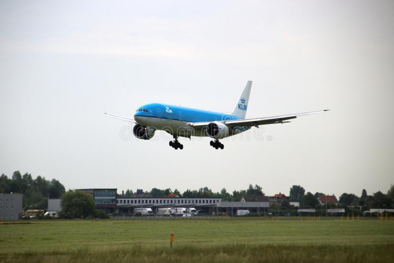 PH-BQD KLM Royal Dutch Airlines Boeing 777-206ER is landing on Amsterdam Schiphol Airport royalty free stock photos