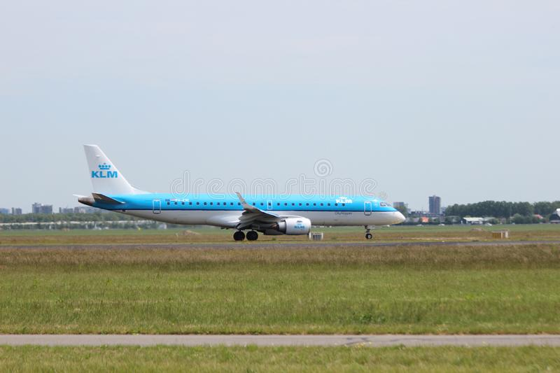 PH-EXC KLM Cityhopper Embraer ERJ-190STD Aircraft landing at the Polderbaan 36L-18R at the Amsterdam Schiphol airport in the Nethe royalty free stock photo