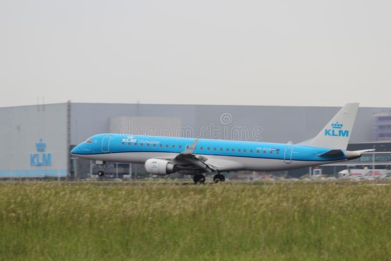 PH-EZH KLM Cityhopper Embraer ERJ-190STD is landing on Amsterdam Schiphol Airport stock photos
