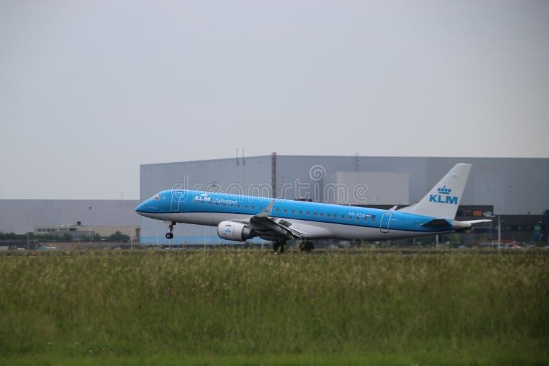 PH-EZK KLM Cityhopper Embraer ERJ-190STD is landing on Amsterdam Schiphol Airport stock photos