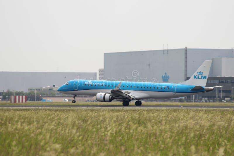 PH-EZM KLM Cityhopper Embraer ERJ-190STD is landing on Amsterdam Schiphol Airpor royalty free stock photo