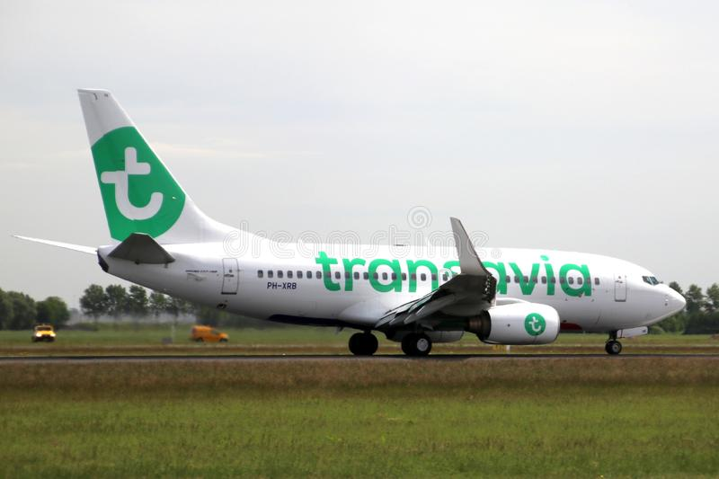 PH-XRB Transavia Boeing 737 Aircraft landing at the Polderbaan 36L-18R at the Amsterdam Schiphol airport in the Netherlands. royalty free stock photo