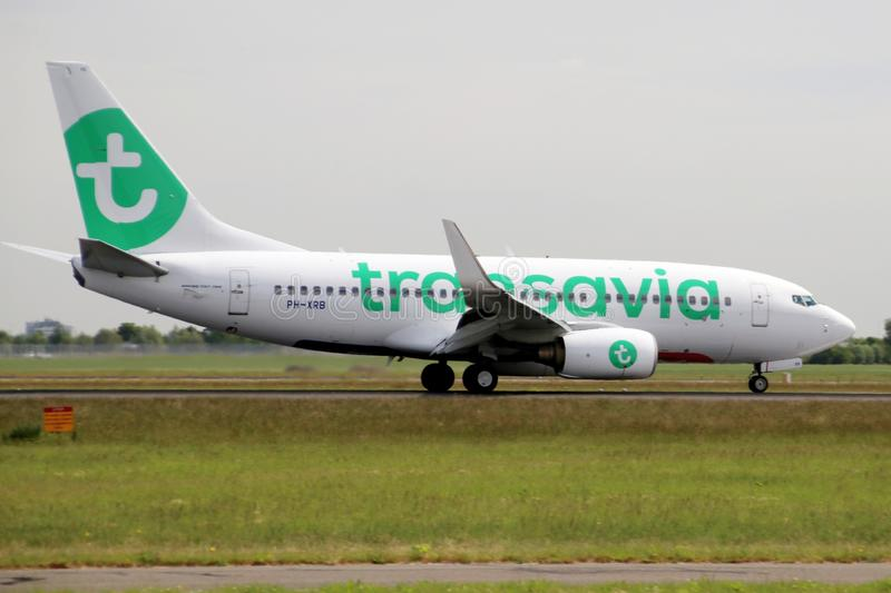 PH-XRB Transavia Boeing 737 Aircraft landing at the Polderbaan 36L-18R at the Amsterdam Schiphol airport in the Netherlands. stock photo