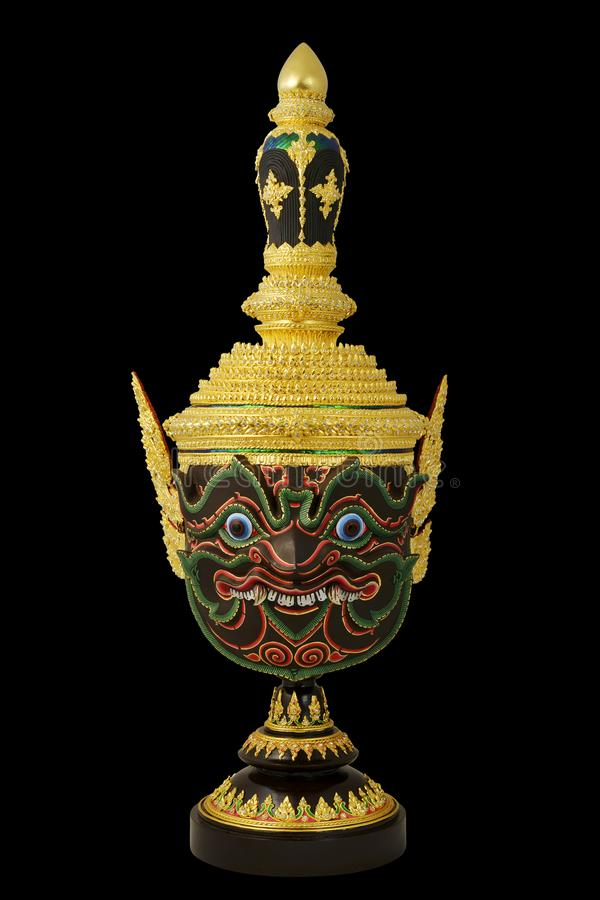 `Pha Rahu` design in Thai traditional actor`s mask or Khon mask with pedestal design high detail. With black isolated background royalty free stock images