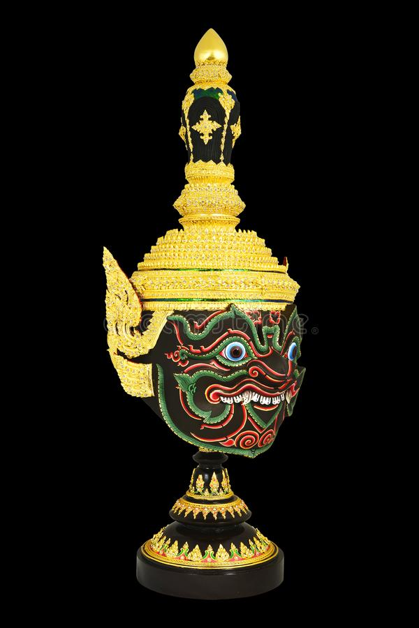 `Pha Rahu` design in Thai traditional actor`s mask or Khon mask with pedestal design high detail. With black isolated background stock photos