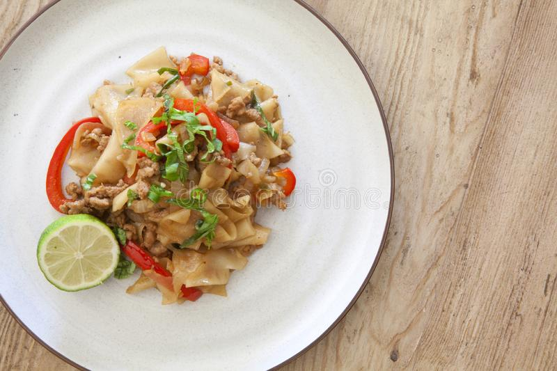 Thai Phad See Ew. Phad See Ew Noodles on a wooden table stock images