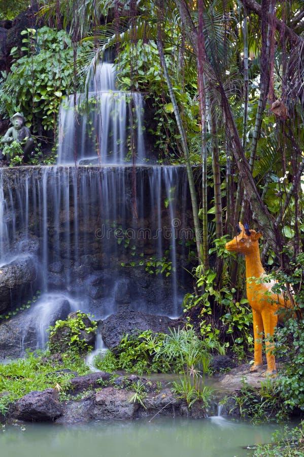 Phalanchai Waterfall and imitation zoo located in public park, Bung Phalanchai Lake, Roi Et Province, northeastern Thailand. Phalanchai Waterfall, artificial stock photography