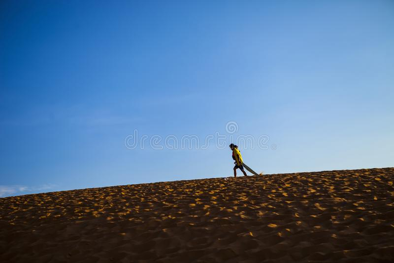 PHAN THIET, BINH THUAN, VIETNAM, May 7th, 2018: Red Sand Dunes and Sky near Mui Ne, Vietnam royalty free stock photo