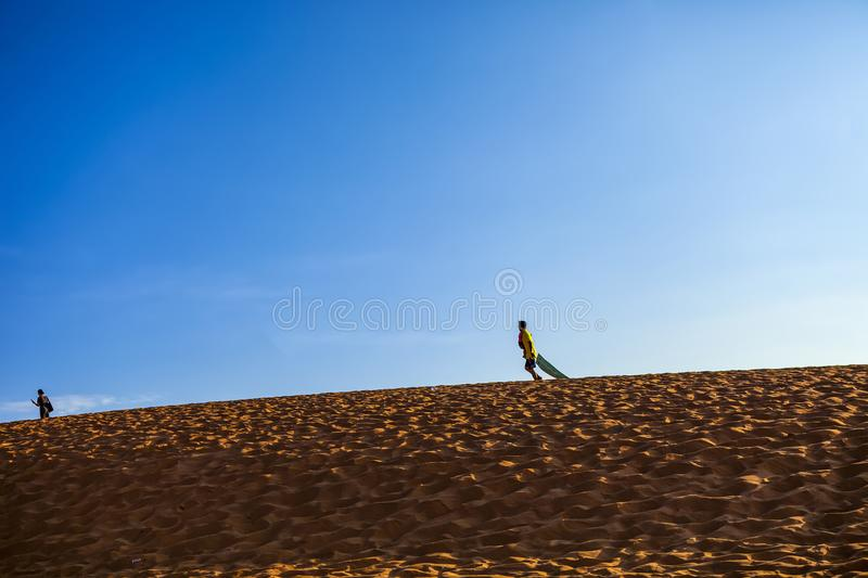 PHAN THIET, BINH THUAN, VIETNAM, May 7th, 2018: Red Sand Dunes and Sky near Mui Ne, Vietnam royalty free stock photography