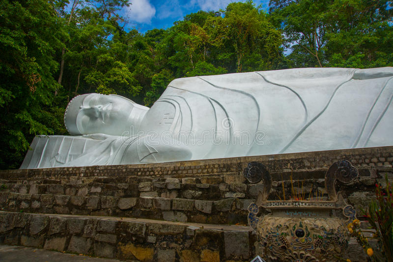 PHAN THIET, VIETNAM.The biggest statue of sleeping Buddha in Vietnam is at Linh Son Truong Tho Pagoda, March 6, 2013, near Phan Th. PHAN THIET, VIETNAM. The stock photography