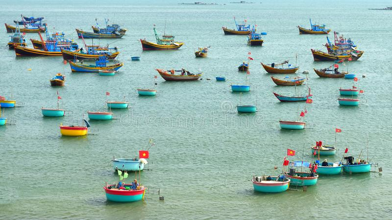 Phan Thiet, Vietnam - May 3, 2018: Fishing boats at fish market of Mui Ne habor in Vietnam stock photo
