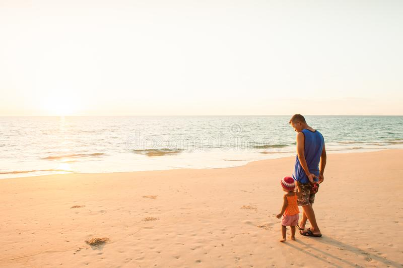 Young girl and father seeing the ocean for the first time. royalty free stock photography