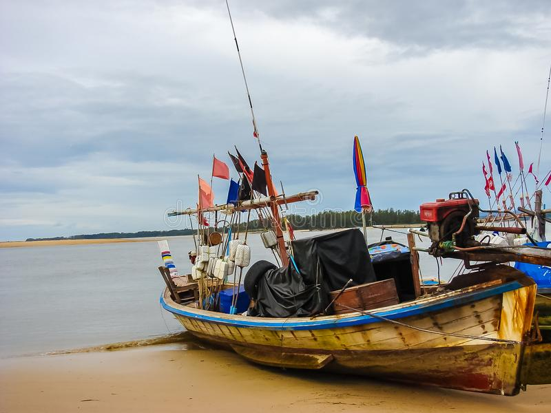 Local fishing boat parked on the beach. stock images