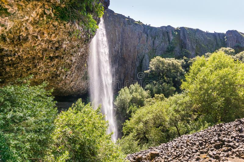 Phantom Waterfall dropping off over vertical basalt walls, North Table Mountain Ecological Reserve, Oroville, California stock images