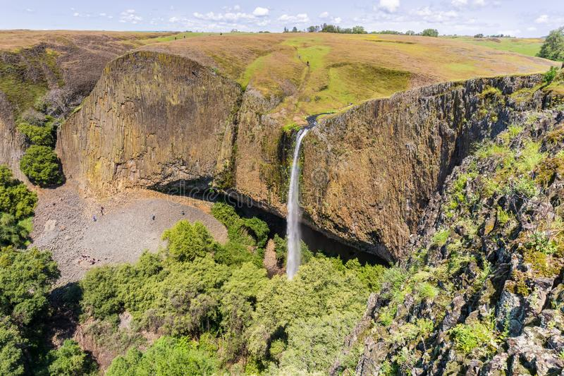 Phantom Waterfall dropping off over vertical basalt walls, North Table Mountain Ecological Reserve, Oroville, California stock photography