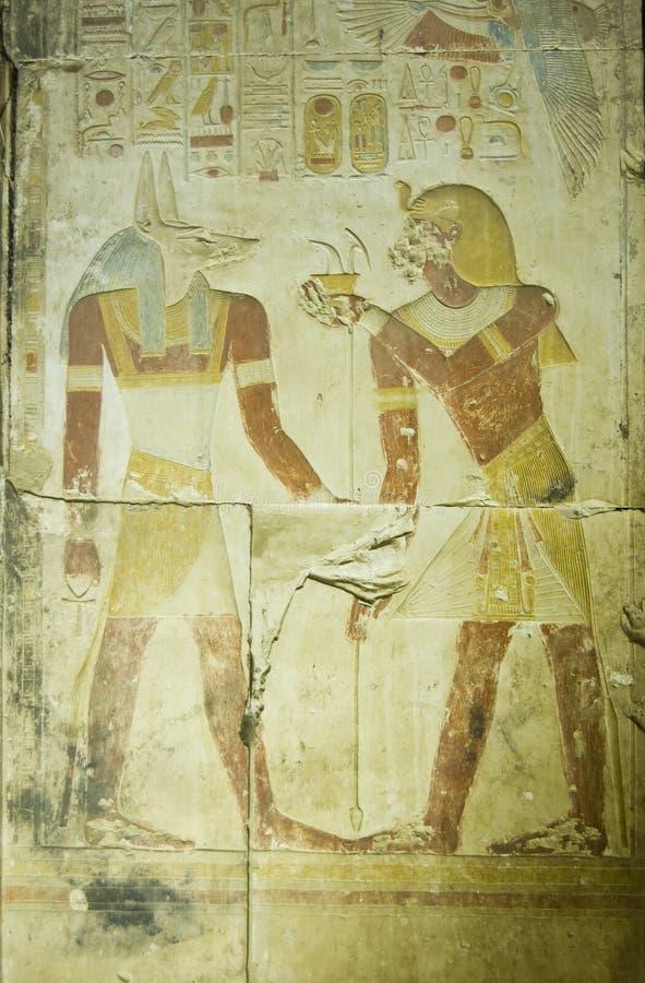 Pharaoh Seti offering to Anubis royalty free stock photography