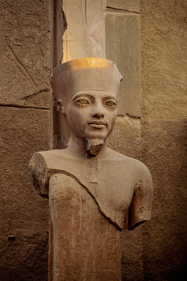 Pharaoh statue in the ancient ruins of the Temple of Karnak in Luxor, Thebes, Egypt stock image
