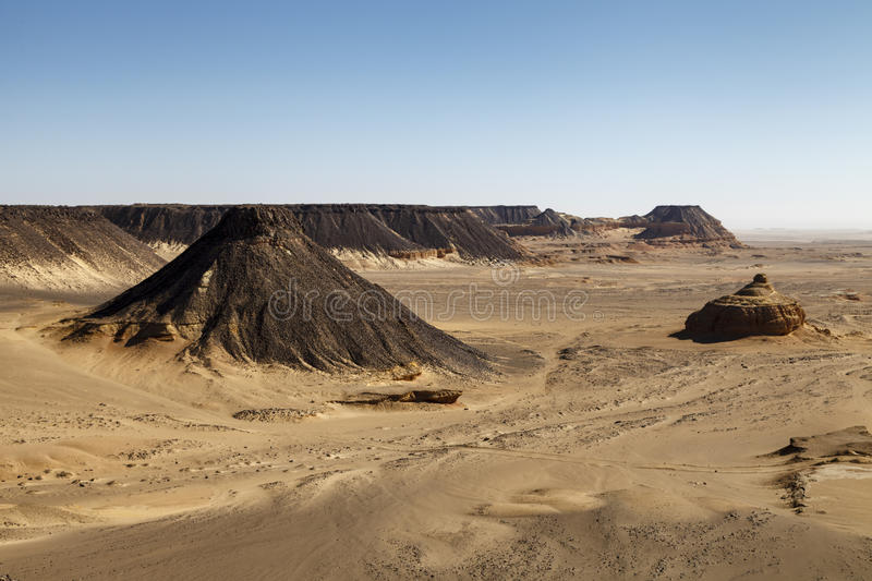 Pharaonic Basalt Stone-pit. The Pharaonic Stone-pit for Basalt known as The Horse' Ears (Wedan El Faras) north of Qarun integrated aesthetic royalty free stock photos