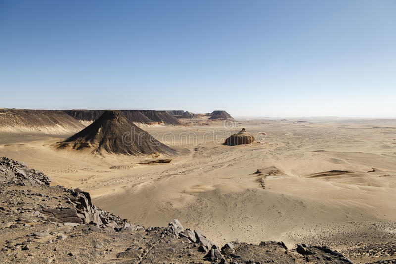Pharaonic Basalt Stone-pit. The Pharaonic Stone-pit for Basalt known as The Horse' Ears (Wedan El Faras) north of Qarun integrated aesthetic stock photo