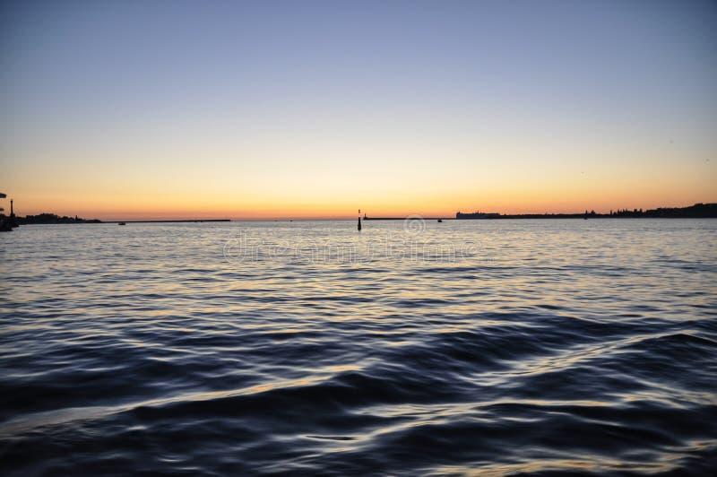 Phare au coucher du soleil images libres de droits