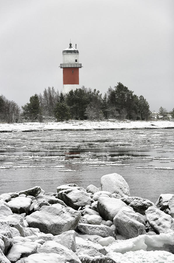 Phare avec l'océan glacial photographie stock