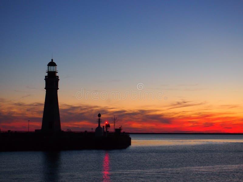 Phare de coucher du soleil photo stock
