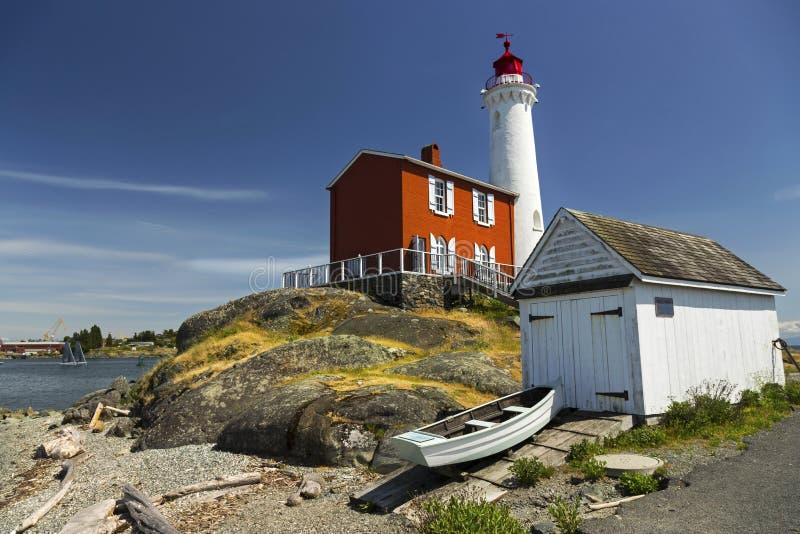 Phare de Fisgard et bateau de pêche Victoria Vancouver Island photographie stock libre de droits