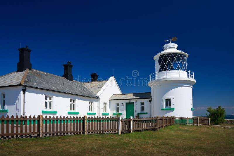 Phare de point d'enclume, Dorset. image stock