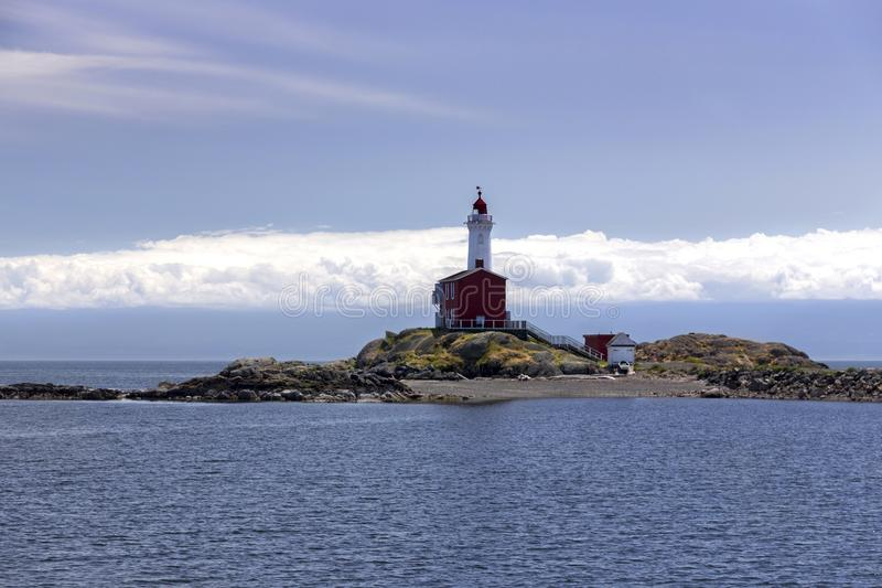 Phare et Juan De Fuca Strait Background Cloudscape de Fisgard photos stock